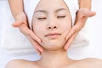 Young woman getting a facial massage, Saipan