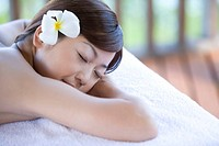 Young woman lying on massage table, Saipan