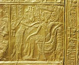 Detail of the exterior of the gilt shrine showing the queen fastening a necklace around the king´s neck, from the tomb of the pharaoh Tutankhamun, dis...