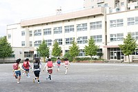 Japanese Students Running At Schoolyard