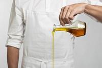 Chef pouring olive oil mid section (thumbnail)