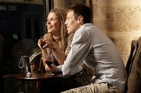 Mid adult couple drinking red wine in restaurant