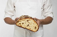 Chef holding loaf of bread (mid section)