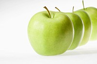 Green apples in row