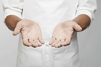 Flour on chef's hand mid section