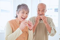 Senior Husband And Wife Who Eat Sandwiches