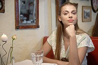 Woman at dining table portrait