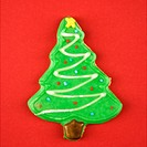 Christmas tree sugar cookie with decorative icing.