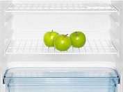 Three green apples in fridge close-up (thumbnail)