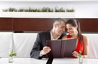 Couple reading menu in restaurant