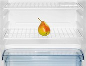 Single pear in fridge (close-up)