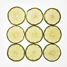 Lime slices arranged in square design on white background