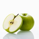 Still life of green apples on white background.