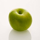 Still life of whole green apple on white background