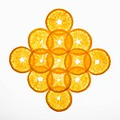 Orange slices arranged in design on white background.