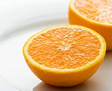 Halved orange against white background