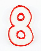 Sugar cookie in the shape of a number eight outlined in red icing