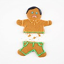 Frowning male gingerbread cookie broken in half