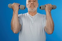 Senior man training with dumbbells (thumbnail)