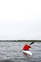 Senior man kayaking in lake