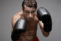 Mid adult man in boxing stance