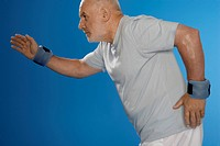 Senior man exercising with wrist weights