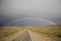Rainbow above the Pampas and highway, Argentina, South America