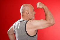 Senior man flexing muscles (thumbnail)