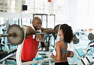 Woman and man talking in gym
