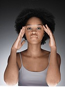 Young woman thinking with hands on face