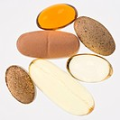 Close up of supplement vitamin pills against white background (thumbnail)