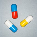 Medical pills on a gray background