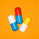 Medical pills on a orange background