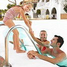 Parents and daughter 6_8 by swimming pool