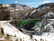 Mountain landscape with bridge crossing over roadway (thumbnail)