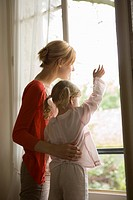 Caucasian mother and daughter looking outside the window, Side View, Rear View, Differential Focus