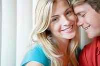Young Couple Cuddling Each Other, Close Up, Looking at Camera