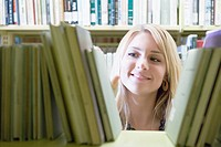 College Girl Looking For Book at School Library