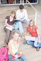 College Students Sitting on Outside Steps