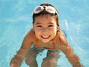 Young girl in swimming pool portrait, high angle view (thumbnail)
