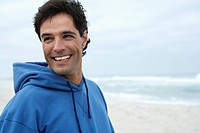 Portrait of mid adult man on beach (thumbnail)