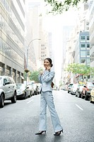 Business Woman On cell Phone in the Middle of Street