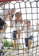 Elementary students climbing play equipment