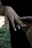 Close_up of Groom placing ring on bride~s finger En brud visar upp sin vigselring.