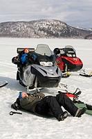 Två Män Solar På Isen Under Skotertur I Borgafjäll , Two People Sitting On Snow