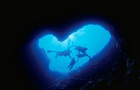 An Underwater Cave And A Diver