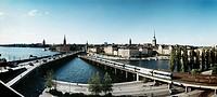 Elevated view of bridge and railroad track Vy över Stockholm från Söder med Södra Järnvägsbron,Centralbron och T_banebron. I fonden Gamla Stan med Rid...