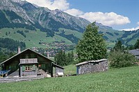 Mountain Range And A House In The Alps In Switzerland
