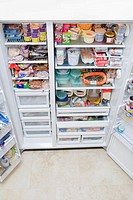Refrigerator filled with assorted food items