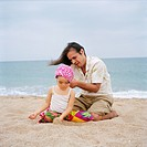 Barceloneta, Barcelona., Father And Daughter4_5 Years Sitting On Beach